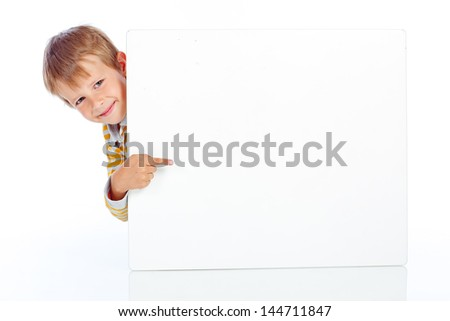 young happy smiling little boy look outs from the blank billboard. Fill-length portrait. Isolated on white - stock photo