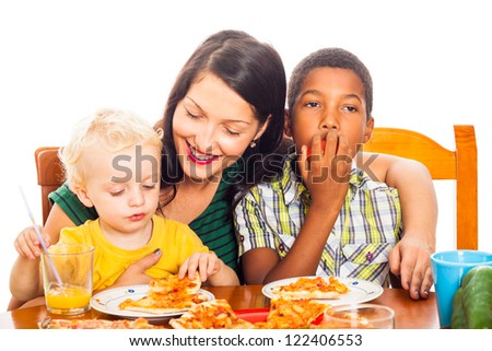 Young happy smiling woman with children eating pizza, isolated on white background. - stock photo