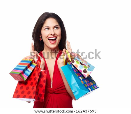 Young happy smiling woman with shopping bags, isolated over white background - stock photo