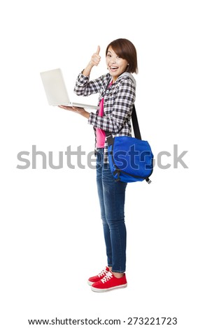 Young happy  student with laptop and thumb up - stock photo