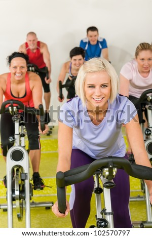 Young happy woman at class enjoy gym workout - stock photo