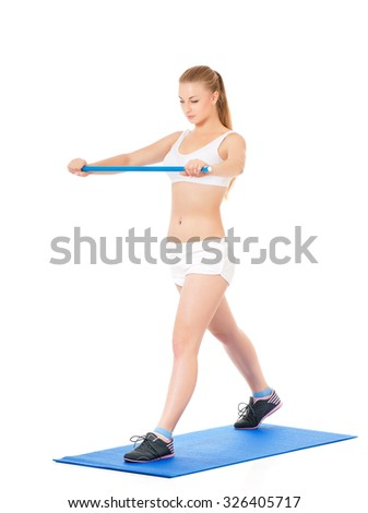Young happy woman doing fitness exercise, isolated on white background - stock photo