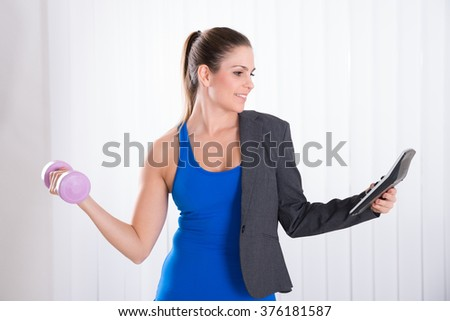 Young Happy Woman Doing Multiple Work. Multitasking Concept - stock photo