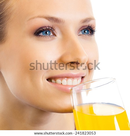 Young happy woman drinking orange juice, isolated over white background - stock photo