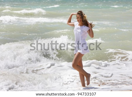 young happy woman having fun in water - stock photo
