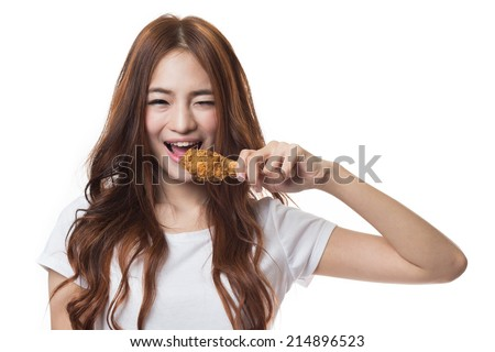 Young happy woman  holding and eating fries chicken on white background - stock photo