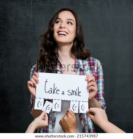 Young Happy Woman Holding Placard With Take A Smile Written On It - stock photo