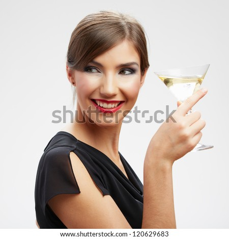 Young happy woman in black dress with glass. Beautiful model portrait isolated over studio background - stock photo
