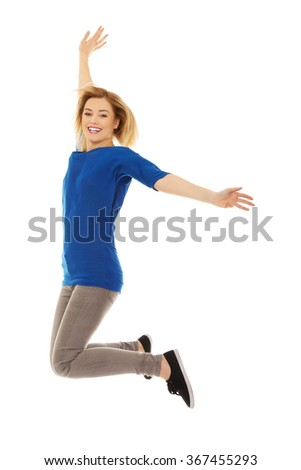 Young happy woman jumping in the air - stock photo