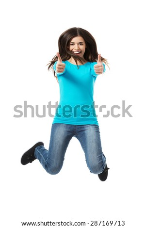 Young happy woman jumping with thumbs up. - stock photo