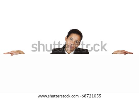 Young happy woman leans on blank billboard. Isolated on white background. - stock photo