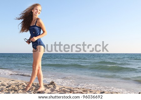 young happy woman on beach - stock photo
