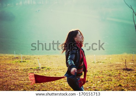 young happy woman run in park misty winter day retro colors  - stock photo