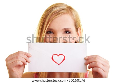 Young happy woman showing a love letter - stock photo