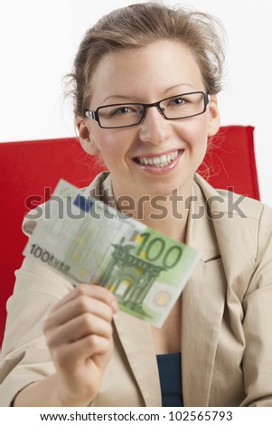 Young happy woman shows green euro note - stock photo