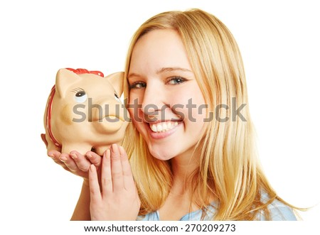 Young happy woman smiling with piggy bank on her hand - stock photo