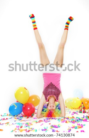 young happy woman standing on her head over white - stock photo