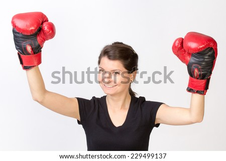 Young happy woman winner of a boxing championship - isolated on white - stock photo