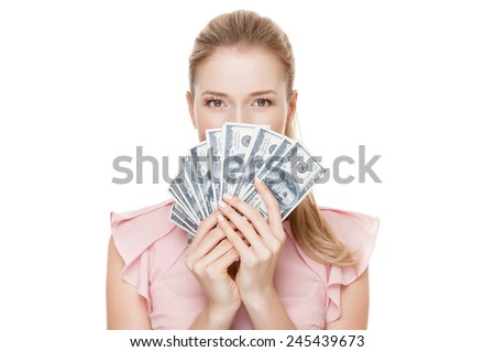 Young happy woman with dollars in hand. Isolated on white background. - stock photo