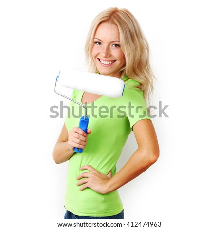 Young happy woman with paint roller isolated on white - stock photo