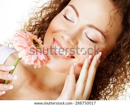 young happy woman with pink flower  isolated on white - stock photo