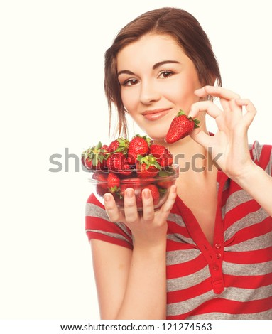 Young happy woman with strawberries - stock photo