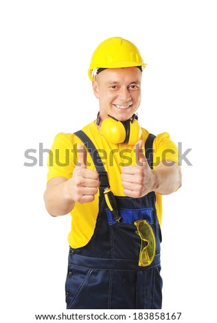 young happy worker in uniform with his thumbs up - stock photo