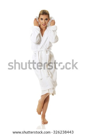 Young happy young woman after bath, isolated on white. - stock photo