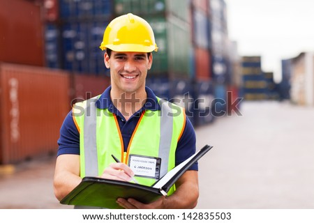 young harbor container depot worker - stock photo