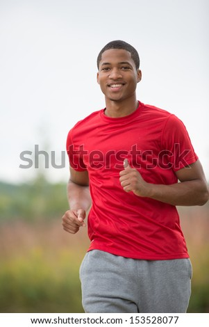 Young Healthy African American Jogging Outdoor Under Morning Sunlight - stock photo