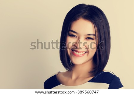 Young healthy Asian woman with smiley face. vintage tone filter. - stock photo
