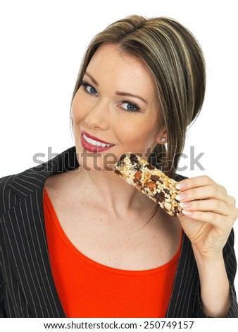 Young Healthy Business Woman Eating a Breakfast Cereal Bar - stock photo