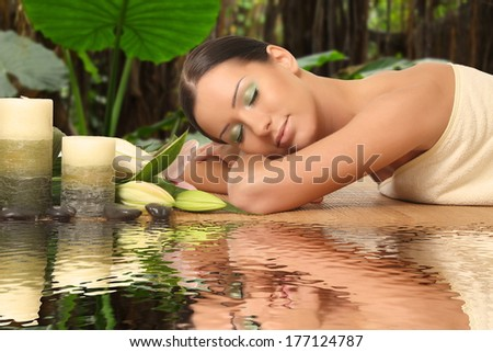 young healthy girl relaxing in spa - stock photo