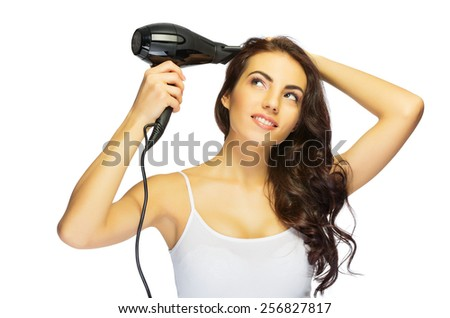Young healthy girl with hair dryer isolated - stock photo