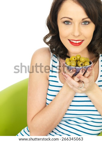 Young Healthy Woman Eating Green Olives - stock photo