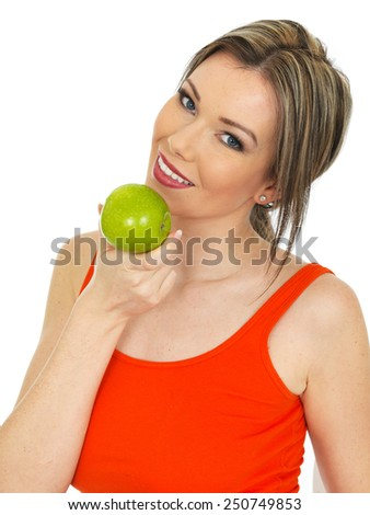 Young Healthy Woman Holding a Fresh Ripe Green Apple - stock photo