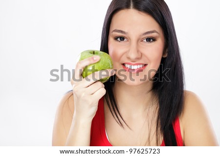 young helthy woman holding fresh green apple - stock photo
