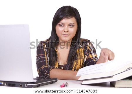 Young high school student studying for exams - stock photo