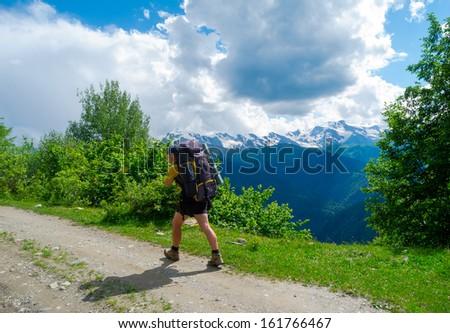 Young hiker trekking in Svaneti, Georgia - stock photo