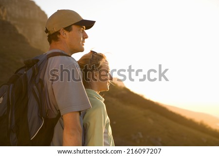 Young hikers looking at view, side view - stock photo