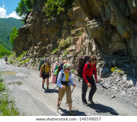 Young hikers trekking in Svaneti, Georgia - stock photo