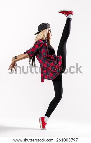 young hip-hop dancer posing in studio - stock photo