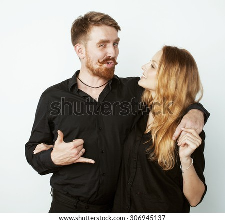 young hipster couple fooling around on white background close up - stock photo