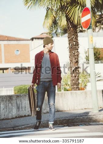 Young hipster fashion guy  vintage lifestyle - Traveler man on retro nostalgic filtered look - stock photo