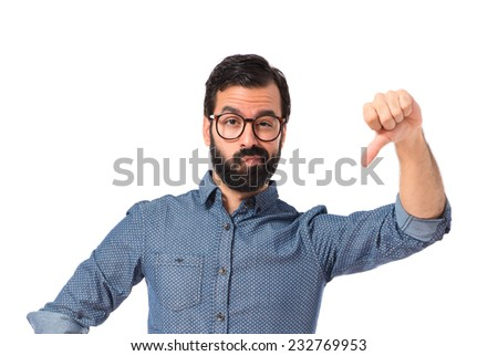 Young hipster man doing bad signal - stock photo