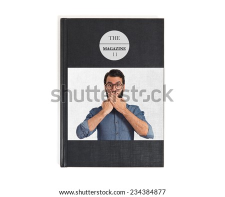 Young hipster man doing surprise gesture - stock photo