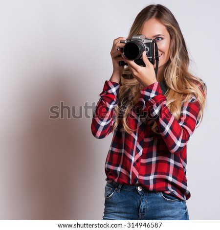 young hipster woman with digital camera smiling  - stock photo