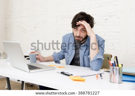 young hispanic attractive  hipster 30s businessman working busy at modern home office with computer laptop dressing casual denim in creative freelancer business success concept - stock photo