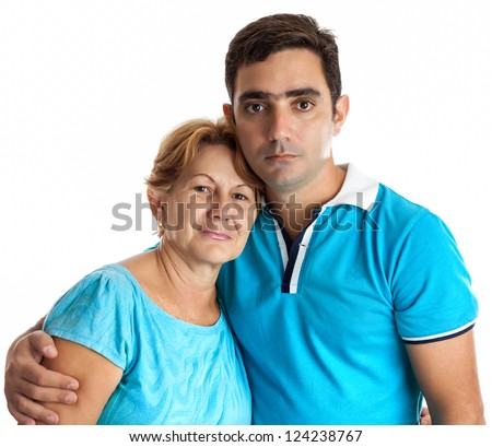 Young hispanic man hugging his mother isolated on white - stock photo