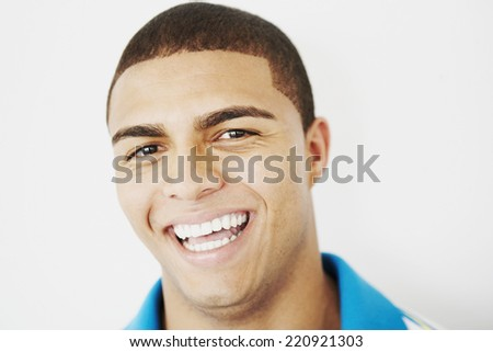 Young Hispanic man laughing - stock photo